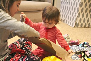 lily's first Christmas unwrapping her gifts...so sweet!!
